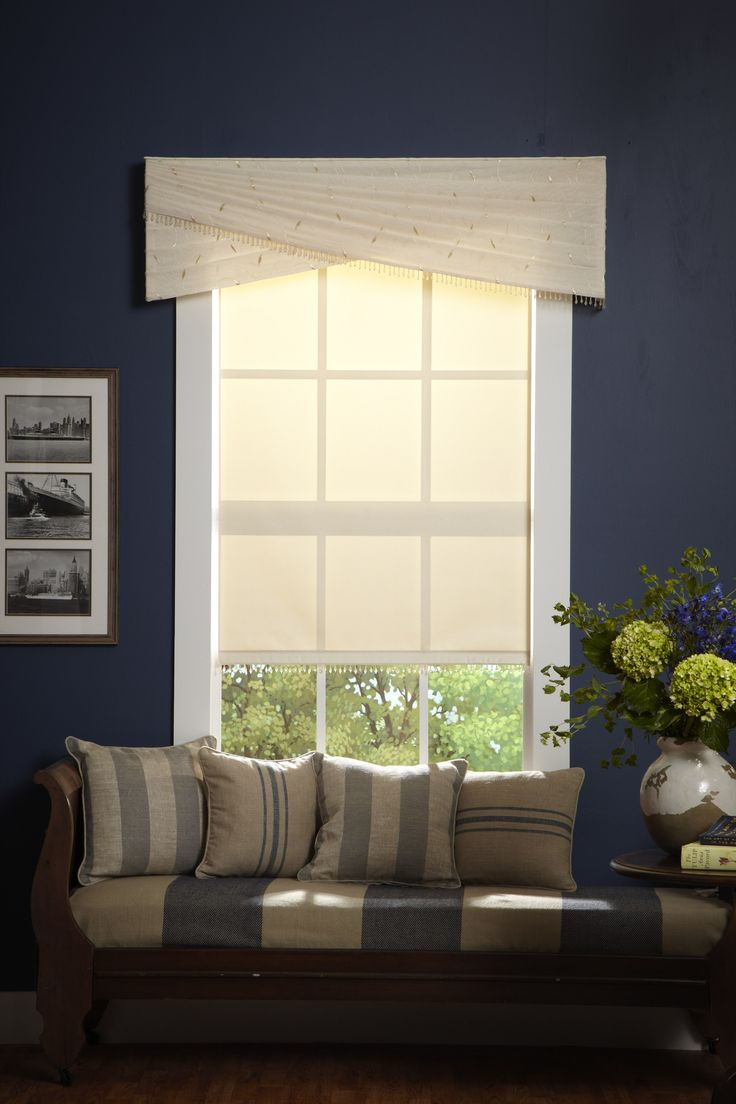 The top treatment on this window changes the room significantly and gives it a more completed look.
