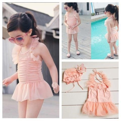 These simply ADORABLE boutique style swimsuits are sure to be the hit at a pool party, at the beach or just running through the sprinklers! Both suit come with matching  skirts for on the go and bonnets to protect childs head from burning in the sun! Vintage Peach suit is lined with chiffon ruffle and lace. Navy stripe is decked out with ruffles and a big pink flower to top it off! Flower is detachable.