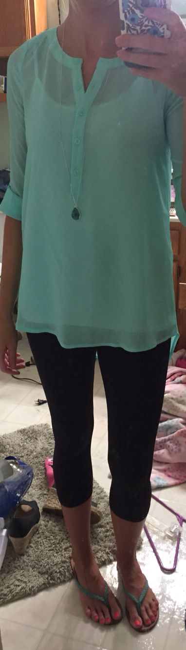 Mint green sheer top with undershirt and black Capri leggings...top is longer in back for coverage...and flip flops long silver necklace with mint jewel accessory
