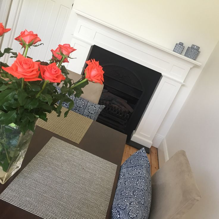 Coral, Navy and Gold. My fireplace and dining area. #fireplace #dining