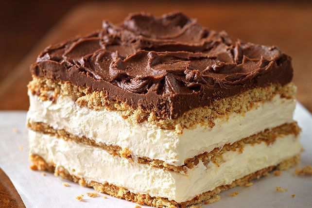 "Graham Cracker Eclair ""Cake"" Our delectably airy treat includes graham cracker layers that become cake-like and soft from the pudding."