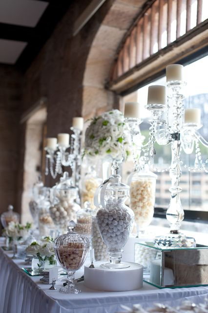 Candy Buffet with candles. You could really make this into a nice arrangements for adults. Careful if there are children around as there is a lot to break here.