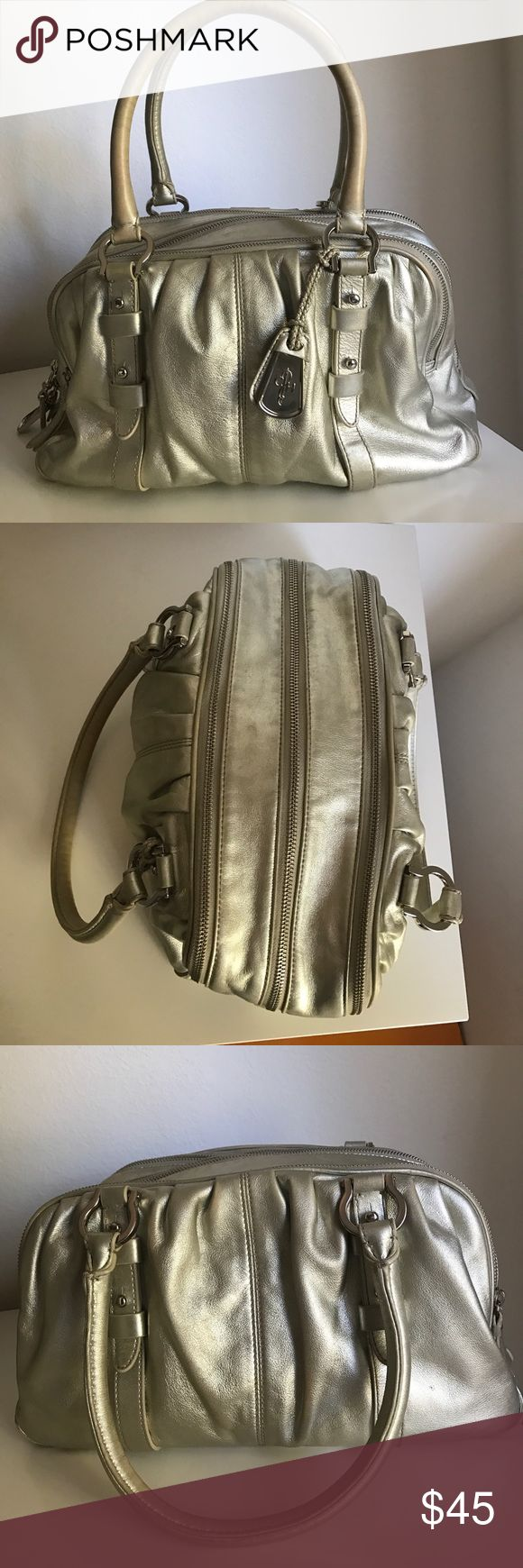 Cole Haan metallic handbag Cole Haan silver metallic handbag. 3 separate zippered compartments for extra storage. Leather. Normal wear and tear. Price firm unless bundled 1008 Cole Haan Bags