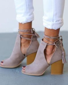 BEST SELLER! These super cute taupe suede booties with chunky heels are a favorite here at Half Moon! Peep toe booties with tassel fringe ties for a one of a kind look. Perfect for spring and summer f