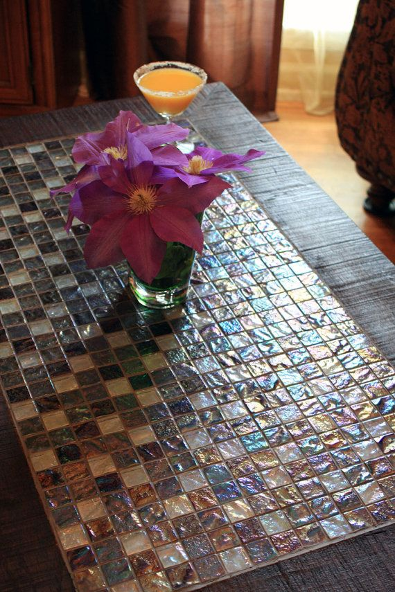 Mosaic coffee table. I would use this on my porch. Might paint the wood white too,