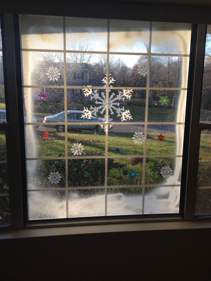 Christmas window art. Spray snow and cling ons