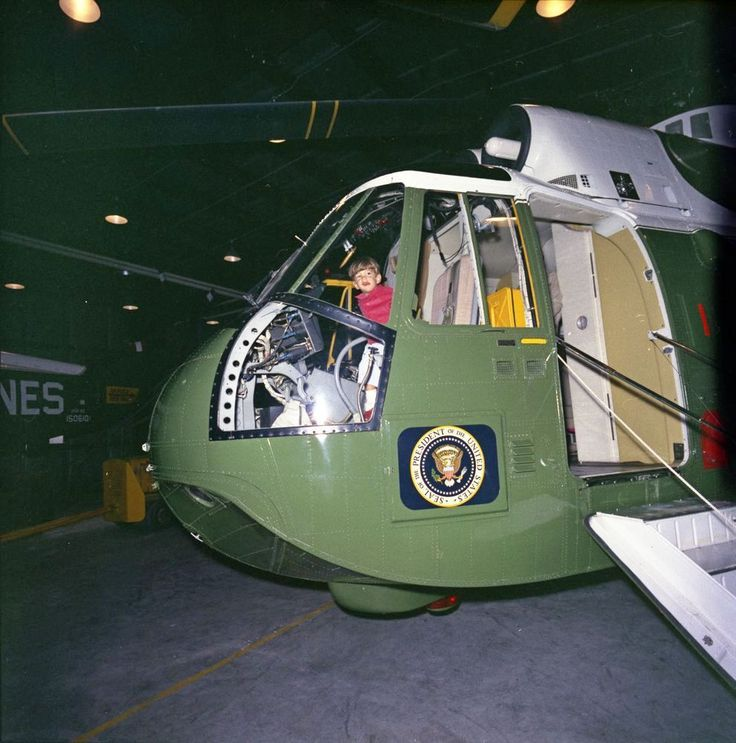 John F. Kennedy, Jr., aged two, sits in the cockpit of the Presidential helicopter during a weekend trip to Camp David March 31, 1963