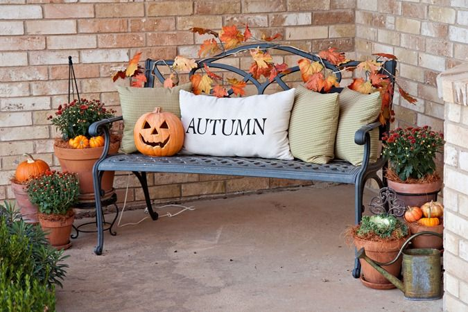 I love the mums in the clay pots with the little pumpkins! Too cute.