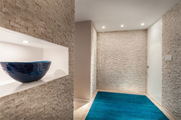 Project by 2id interiors - South Beach     Beach Contemporary Elegant Cozy Beach Foyer. Travertine marble stone Wall and floor. Lid niche in white lacquer.