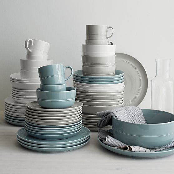 Our fresh, contemporary porcelain pattern from designer Aaron Probyn tells a mix 'n' match color story, hand-glazed in eight soft, soothing hues. Simple artisanal shapes feature grooved detailing and a glowing, glossy finish, here in neutral light grey. Due to their handcrafted nature, slight variations will be present.