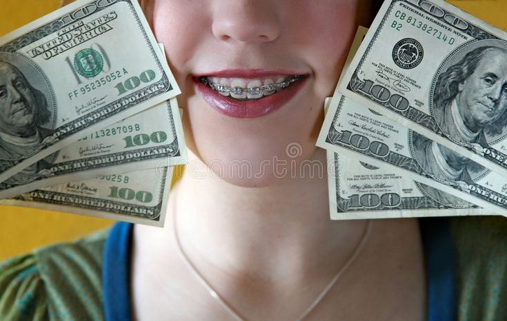 Money for braces. Image of a teen girl holding 100…
