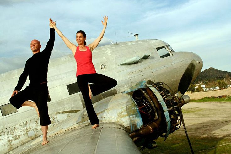 A fun #photoshoot with Douglas Spotted Eagle photographing us on the wing of a #DC3. #photography #trust #communication #partner #acroyoga #yogaFLIGHT
