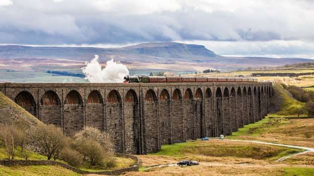 The Flying Scotsman crosses the Ribblehead Viaduct in the Yorkshire Dales today -  marking the re-op - Graham Eva/REX/Shutterstock