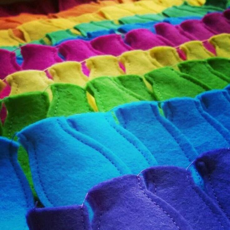 Felt Christmas light bulbs all lined up & ready for stuffing - looking like a beautiful rainbow!