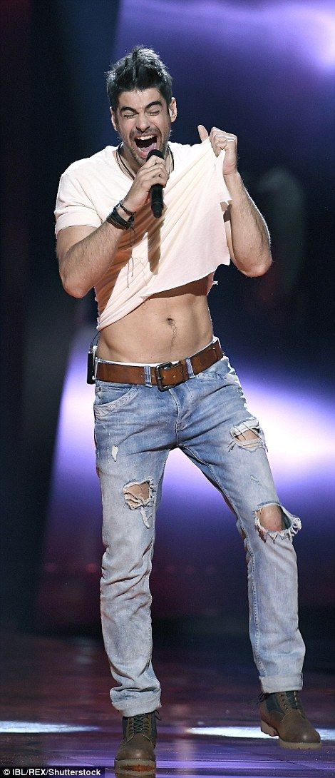 Abs appeal: Freddie, of Hungary, revealed a little more than intended as he lifted up his shirt while performing the song Pioneer at Eurovision 2016
