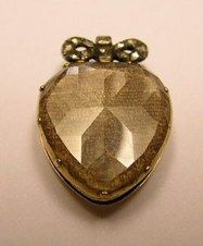 Stuart Crystal Portrait Pendant  circa 1690s.  Stuart crystals were first popularized in 1649, when Charles I, the martyred King of England, was executed under Cromwellian rule. Royalists wishing to show their sympathy for the fallen monarch would wear small slides set with the King's portrait underneath a faceted crystal, or a swatch of hair with the King's initials beneath worked in fine gold wire.