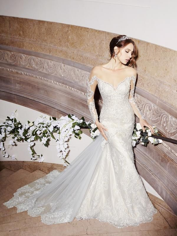 LOVE everything about this! Moonlight+Style+H1299 Lace+appliques+embellish+the+fitted+bodice+from+the+drop+waist+and+along+the+luxurious+illusion+long+sleeves.+The+sheer+jewel+back+provides+coverage+with+pearl+buttons+leading+to+a+detachable+cathedral+train.