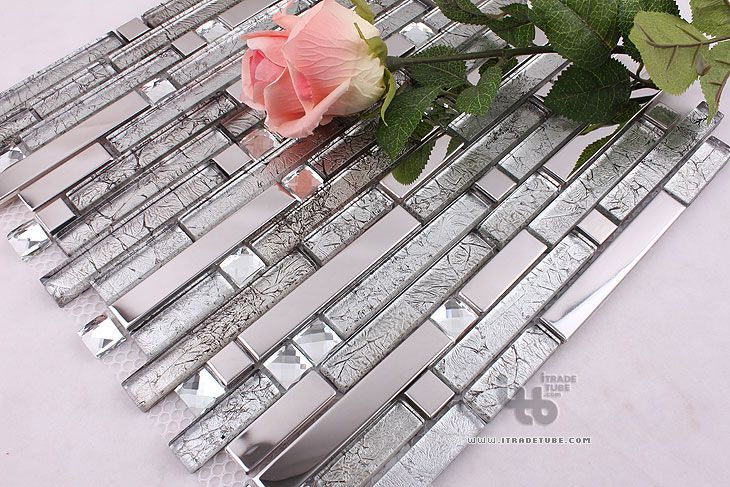 #bldgproductoftheday stainless steel and glass mosaic tile; very unique and beautiful! It's smart choice for small spaces because it will reflect a lot of light around the room and make it feel bigger and look much brighter.