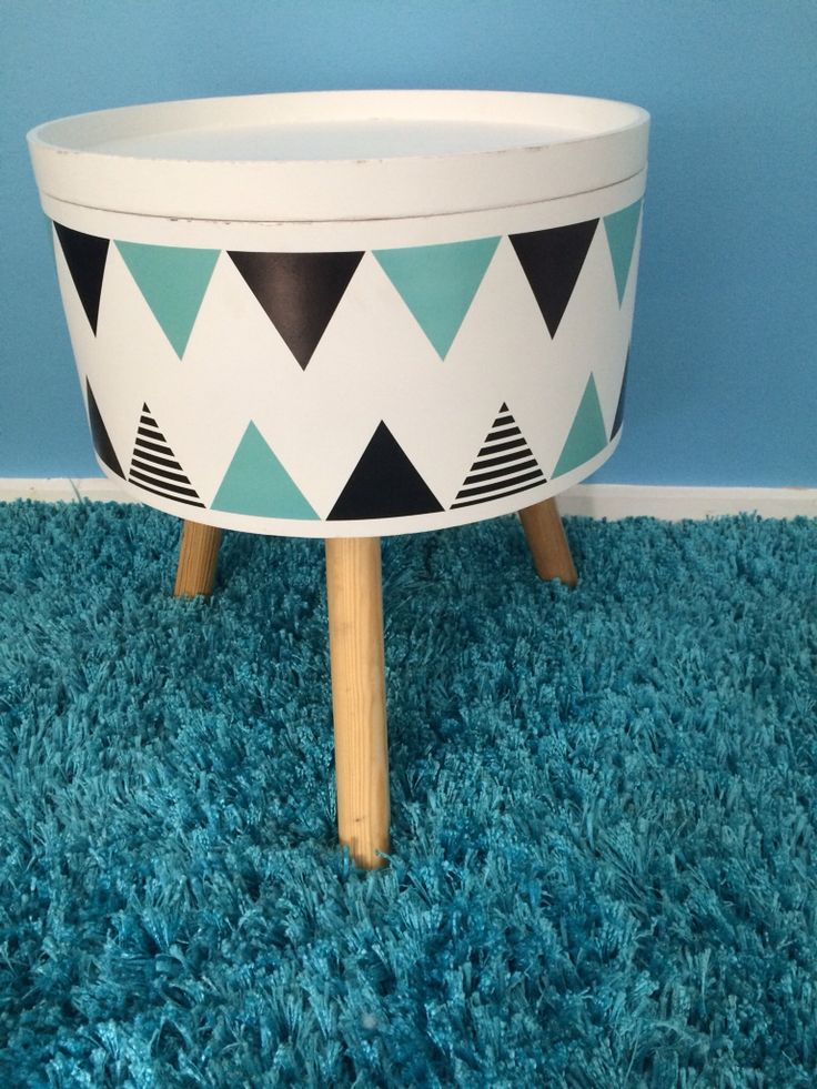 Cute storage table with wall decor stickers  such a fun piece for a kids room