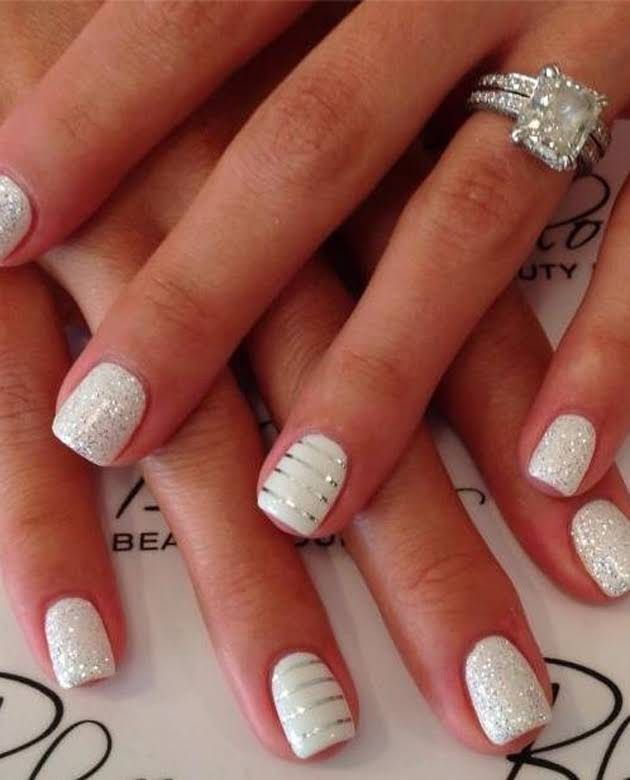 Stripe and sparkle wedding nails to help show off your engagement ring #nailart | #clairetaylor
