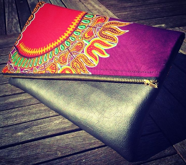 Shop this leather and dashiki clutch by Craft Your Stitch Up here: www.craftmystitchup.etsy.com