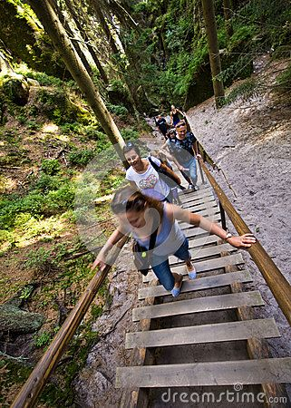 Hikers on wooden steps in Adrspach Teplice, Rock Town Park, Czech Republic.