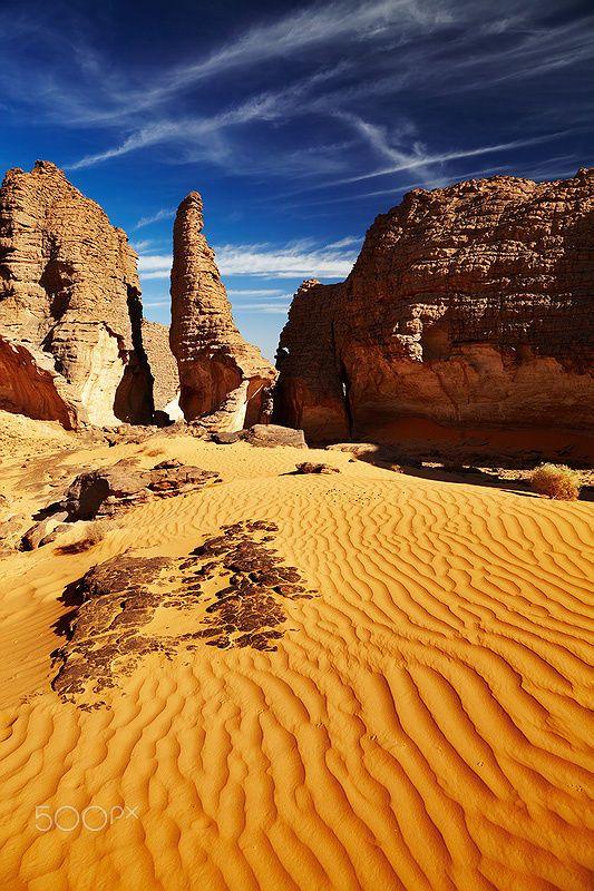 Bizarre sandstone cliffs in Sahara Desert, Tassili N'Ajjer, Algeria // Dmitry Pichugin