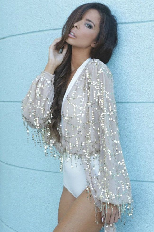 Get ready for all eyes to be on you in the All That Glitters Sequin Top! This gorgeous top features a sheer sequin spangle fabric with bell sleeves and a sexy tie waist. Wear this over a cami for a se