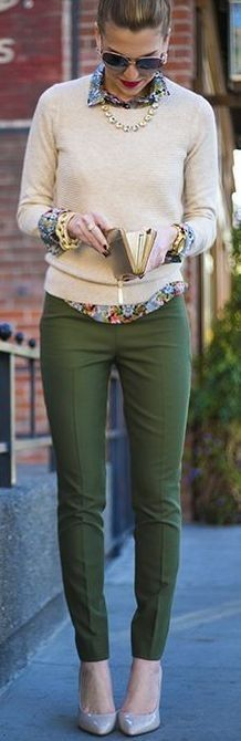 I like the printed top and neutral sweater paired with fitted, colored pant. No a fan of the actual print or the jewelry.