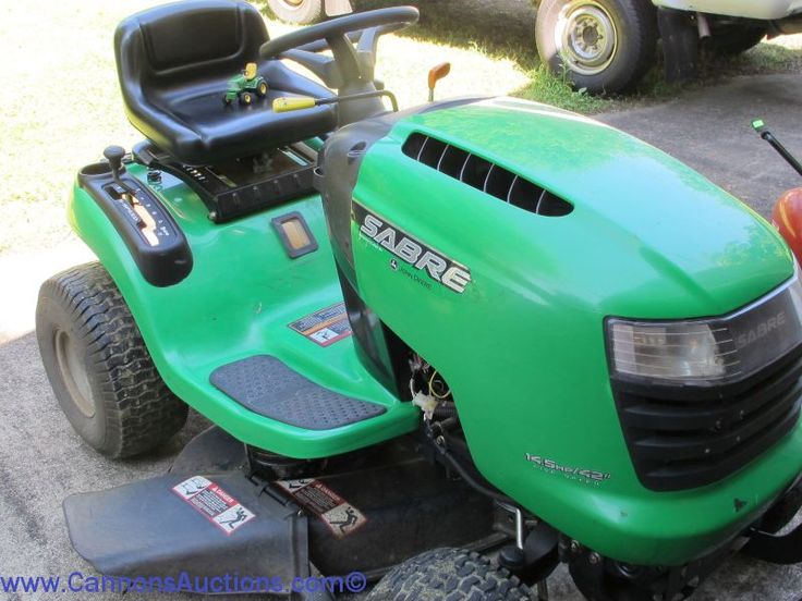 """John Deere Saber Lawn Tractor, 14.5 hp/42"""", five-speed, showing 167.7 hours; in good running order; hours showing may change due to grass cutting prior to sale close; includes operating manual and extra belt"""