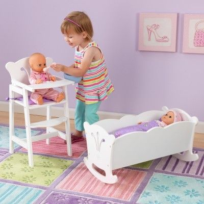 With scalloped trim and filigree cutouts, KidKraft's rocking Lil Doll Cradle is the perfect resting place for every little girl's baby.