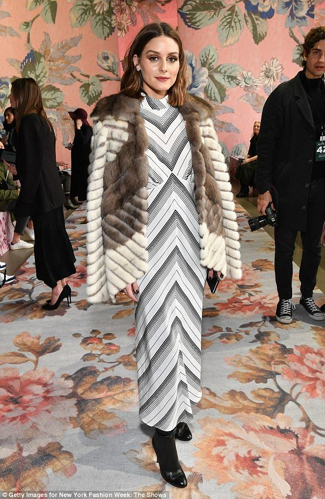 Strike a pose: Her retro-inspired grey-and-white striped gown hit just below her ankles to reveal a pair of black boots
