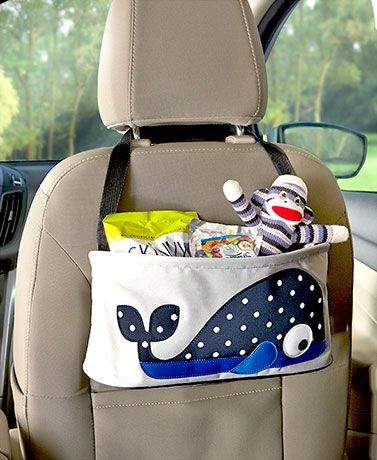 Use this Whimsical Headrest Organizer Bag to keep all your little one's road trip essentials within reach. Featuring a colorful animal image, it hangs from the headrest into the back seat and holds drinks, snacks, books or toys. Has a strap to attach it