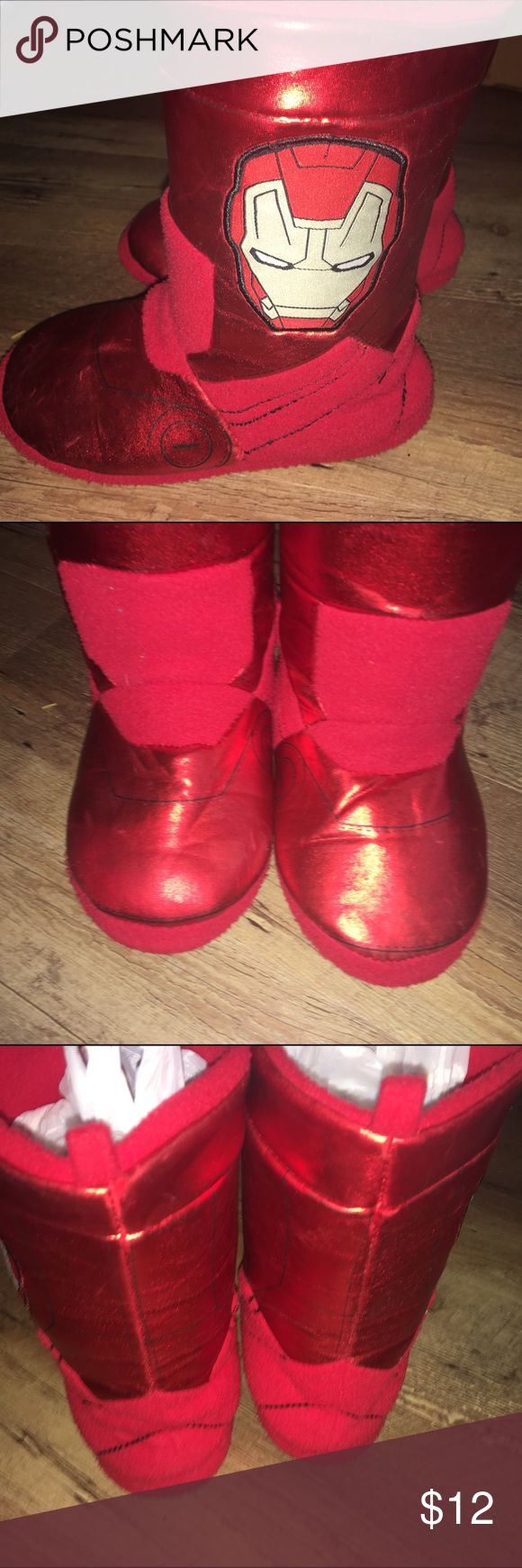 Iron man House Shoes Iron man House Shoes  Size 1-3. Hardly worn. My son has outgrown his love for Iron man. It used to drive me crazy because everything he wanted had iron man until he got to big. Now I'm just sad.  Price firm unless bundled with other listings from my store. Ship same day. No trades.   #houseshoes #boyshouseshoes #ironman #disney #nighttime #boys Disney Shoes