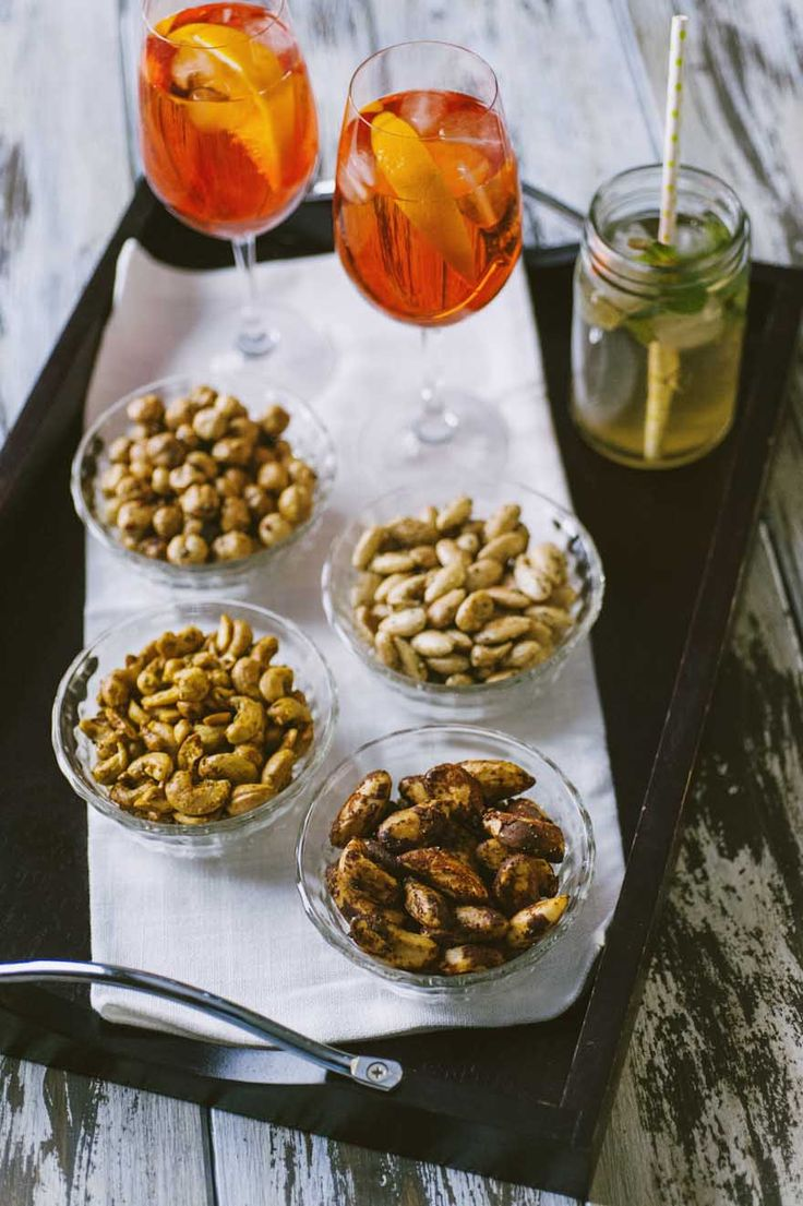 Dried fruit aperitif, served to accompany a spicy spritz, Hugo and other cocktails