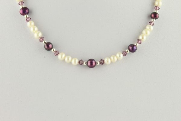 White and wine coloured potato pearls accented with silver beads and amethyst crystals.