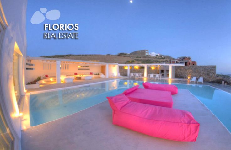 Outdoors, there is a pool with two pergolas for lounge and dinner as well as large areas with barbeque facilities for outdoor dining and built-in living room that can accommodate 15 people. FMV1174 Villa for Sale on Mykonos island Greece. http://www.florios.gr/en/Villas-For-Sale-Mykonos-Island-Greece.html