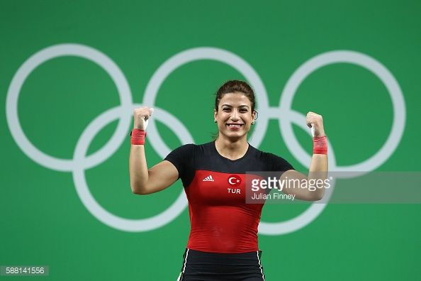 Duygu Aynaci of Turkey celebrates after lifting during the Women's 69kg Group B weightlifting contest on Day 5 of the Rio 2016 Olympic Games at...