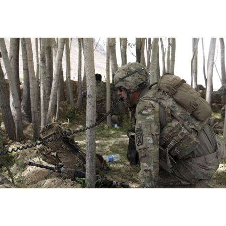 US Army soldier communicates possible enemy locations during combat in Afghanistan Canvas Art - Stocktrek Images (35 x 23)