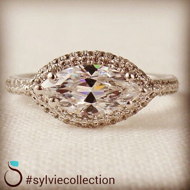 Sometimes a 90 degree turn can make all the difference.  http://www.sylviecollection.com/modern-east-west-marquis-diamond-engagement-ring-sy630-mq.html