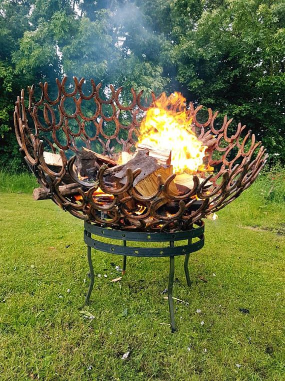 Constructed from reclaimed horse shoes individually welded into a solid fire pit. Includes sturdy stand constructed from 10mm thick steel and and internal removable ember tray for easy upkeep. These pits are 800mm diameter.