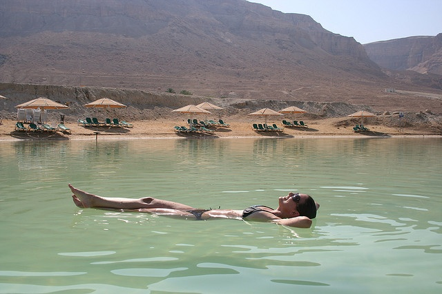 Dead Sea (Israel). 'Floating in the Dead Sea is one of the world's great natural experiences. Thanks to an eye-stingingly high salt content it is virtually impossible to swim in the viscous waters of a sea that is 1000ft lower than sea level. The experience is usually accompanied by a mud bath, a bake in the sun and a health-giving spa treatment. Our facial Masks leave you feeling as great