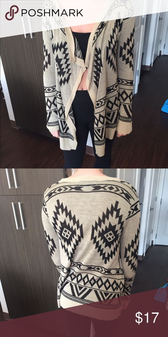 NWOT Tribal print cardigan!! NWOT Tan and black tribal print cardigan! Perfect for far and a great piece for layering!! Never worn and in excellent condition!! Sweaters Cardigans