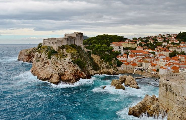 Waves crash against the rocks of the fortress Lovrijenac, built in 1018, in Dubrovnik, Croatia.