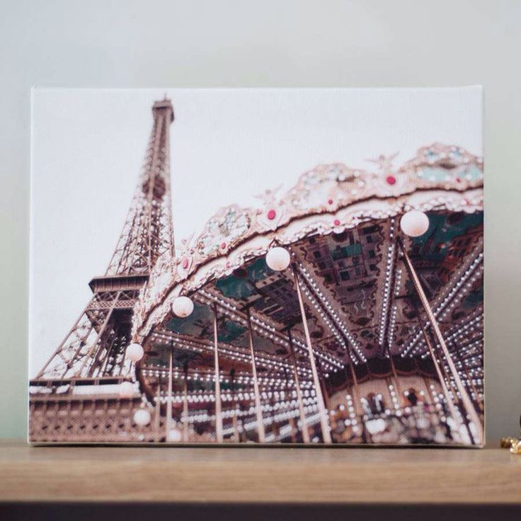I've just found Carousel Of Paris Ready To Hang Canvas. This stunning canvas art print features the Eiffel Tower and the gorgeous carousel who sits in her shadows.. £25.00