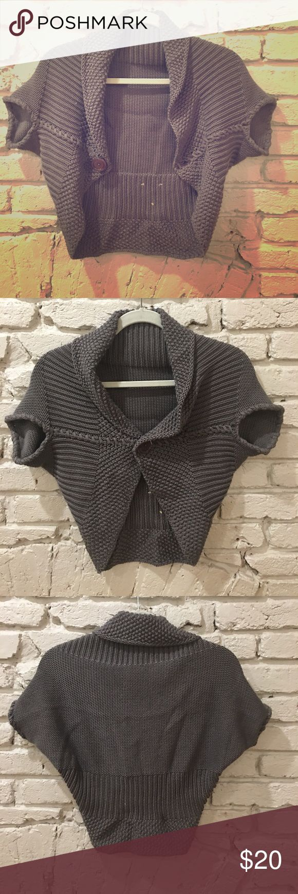 Italian knit shrug genuine made in impeccable Italy dark grey shrug.  Feels like a thick cotton. Comfy.  See pic for what looks like little bleach drops on interior not exterior. Sweaters Shrugs & Ponchos