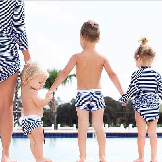 Uv Swimwear for the whole family!  I love seeing families all match match! How cute is this family of 5 (baby 4 is on the way)!!  We love our 2017 little boys swim shorties (euro swim shorts)  they are adorable and go from 6-12 M through is 6!    Shop more colors, more styles, more sizes of UV Swimwear by SwimZip http://www.SwimZip.Com