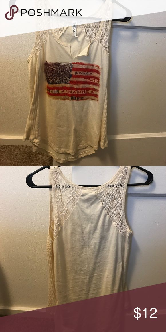 Adorable patriotic Tank Top Cute American flag tank top v-neck! I got this at T.J. Maxx for the 4th of July last year and it's too small now :( only worn once and no pets and smoke free home! It's really comfy and it Falls a little longer in the back than the front! Others Follow Tops Tank Tops