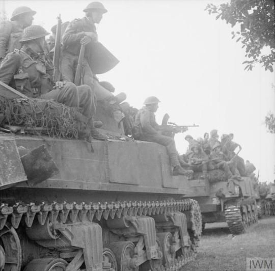 WW1,WW2 PHOTOS & FILMS    Sherman tanks carry infantry forward for the start of Operation 'Goodwood', 18 July 1944.