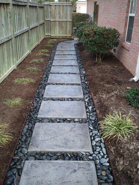 Beautiful concrete pavers and river rock garden decor for Garden path designs pavers
